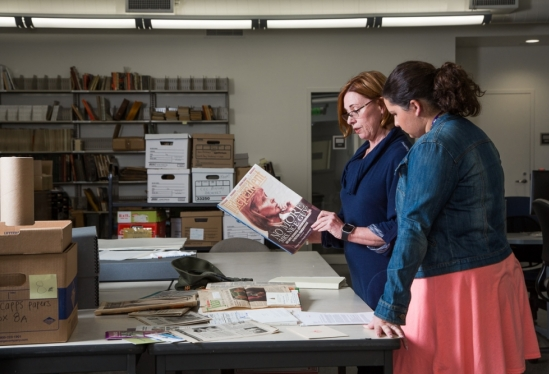 UCSB Library's Danelle Moon and Carla Altomare work with Lois Capps' papers